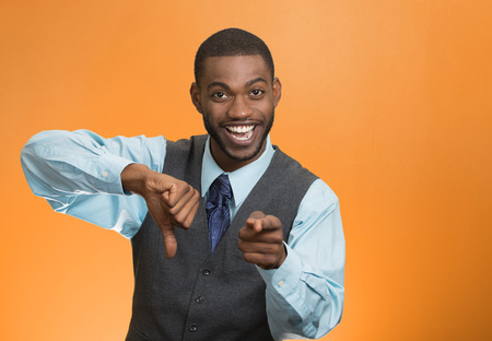 offend: Closeup portrait sarcastic young man showing thumbs down sign hand gesture