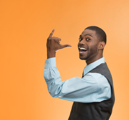 get out: Portrait happy silly goofy man gesturing with hand thumb to go out party get drunk Stock Photo