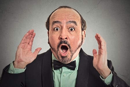 no fear: Surprise astonished man. Closeup portrait man looking surprised in full disbelief wide open mouth isolated grey background. Positive human emotion facial expression body language. Headshot funny guy Stock Photo