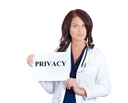 hippocratic: Portrait female healthcare professional doctor scientist researcher pharmacist holding privacy sign isolated white background.