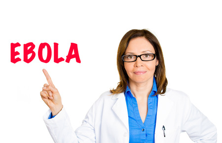 symptomatic: Doctor healthcare professional pointing at ebola warning message on signboard isolated white background. Virus epidemic pandemic outbreak symptoms clinical diagnosis, treatment concept. CDC measures Stock Photo