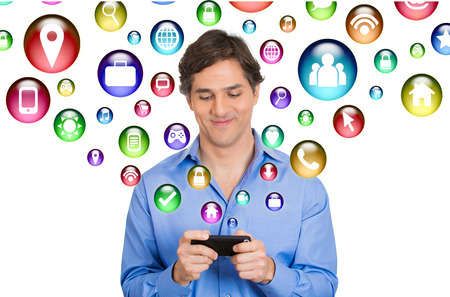telecom: communication technology mobile phone high tech concept. Happy business man using texting on smartphone social media application icons flying out of cellphone isolated white background. 4g data plan