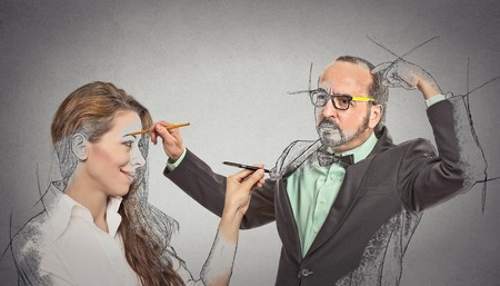 selfcontrol: Create yourself, future destiny, image career. Attractive woman, middle aged guy drawing picture sketch of each other by memory isolated grey background. Human face expression determination creativity