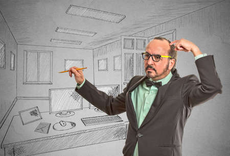 flexible business: Portrait thoughtful middle aged man graphic designer drawing with pen pencil sketch of future apartment. Architecture home renovation remodeling concept isolated grey wall background. Face expression