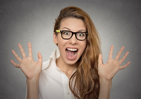 super excited funky young girl looking thrilled very happy isolated on grey wall background Stock Photo