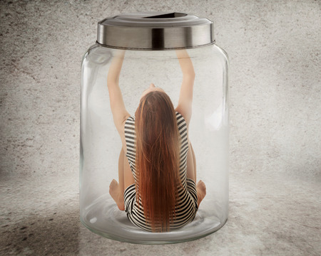 arrest women: Lack, violation of human rights liberty. Young lonely woman sitting in glass jar isolated grey wall background. Suppression of freedom, restrain, employee working conditions, life limitation concept