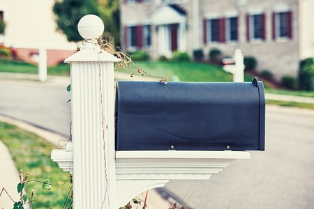 mail address: Mail Box on a house background Stock Photo