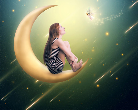 young people fun: Beauty lonely thoughtful woman sitting on the crescent moon looking up on falling stars. Dreamland imagination screen saver background. Face expression, emotion, life perception Stock Photo