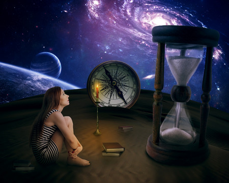Lonely girl in a middle of desert looking up on starry sky dreaming imagining life on a different planet thinking about future life. Dreamland concept idea screensaver photo