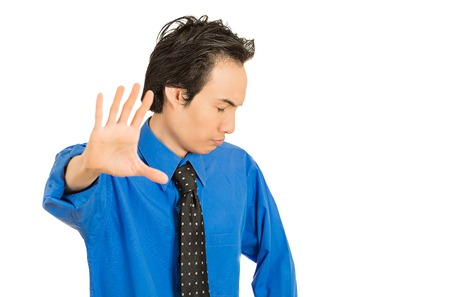 Closeup portrait young grumpy man with bad attitude giving talk to hand gesture with palm outward isolated white background. Negative emotion facial expression feeling body language life perception
