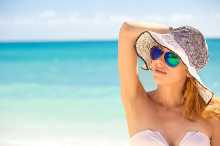 Closeup portrait happy young woman on the beach, beautiful female enjoying tropical sunny weather, pretty healthy girl relaxing outside, nature fun joy, spa, travel, paradise getaway, vacation concept photo