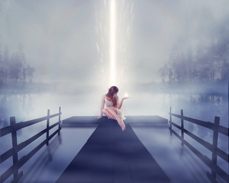 Lonely woman sitting on pier with bright ball of glowing light in her hand lake background. Human emotion life perception feeling sign symbol spirituality concept. Abstract idea screensaver background