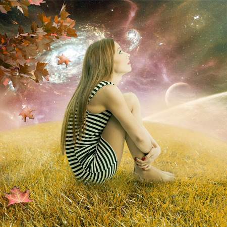 stargazing: Dreaming young woman sitting on meadow earth looking up at starry sky with planets spinning around orbit. Ecology cosmos stargazing concept. Dreamland outdoors relaxation environment screen saver