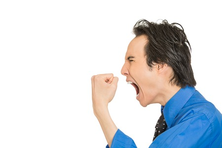 Side profile portrait bitter mad displeased pissed off angry grumpy corporate man open mouth hands fist in air screaming isolated white background. Negative human emotion face expression feeling