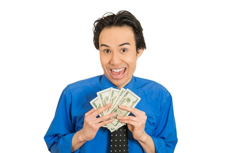 financial reward: Closeup portrait super happy excited successful young business woman holding money dollar bills in hand isolated white background. Positive emotion facial expression feeling. Financial reward concept Stock Photo