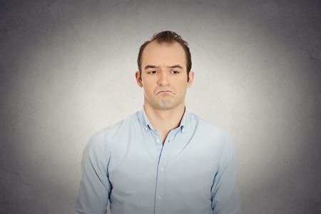 business skeptical: Closeup portrait of angry sad annoyed skeptical, grumpy business man upset employee worker isolated grey wall background. Human emotions face expression reaction interpersonal conflict resolution