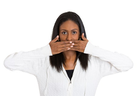 closed mouth: Closeup portrait middle aged woman covering closed mouth with hands open eyes. Speak no evil concept isolated white background. Negative human emotion facial expression sign symbol. Media news coverup Stock Photo