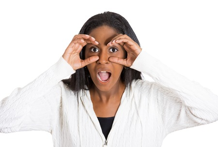 woman searching: Closeup portrait headshot young, middle aged curious surprised shocked woman peeking, through fingers like binoculars searching something looking into future isolated white background. Face expression