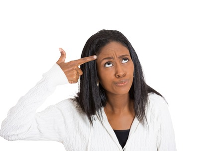 duh: Portrait stressed annoyed middle aged woman with hand finger gun gesture frustrated made mistake isolated white background. Negative human emotion face expression feeling life perception body language