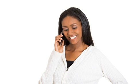 Closeup portrait headshot young happy attractive woman professional talking on cell smartphone isolated white background. Positive face expression. Technology communication building business concept photo