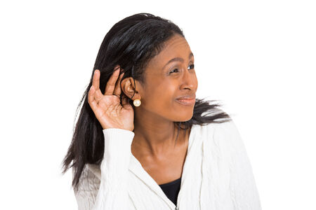 hertz: Closeup portrait unhappy hard of hearing woman placing hand on ear asking someone to speak up listening to bad news isolated white background. Negative emotion, facial expression, feelings, reaction Stock Photo