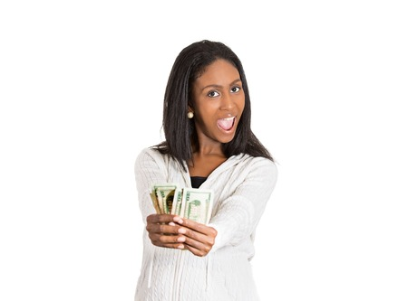 Closeup portrait super happy excited successful young woman holding showing money dollar bills in hand isolated white background. Positive emotion facial expression feeling. Financial reward savings Standard-Bild