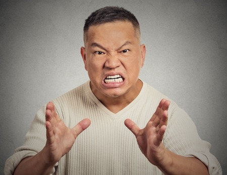 Portrait, bitter, displeased angry, grumpy man yelling screaming isolated grey wall background. Negative human emotion facial expression photo