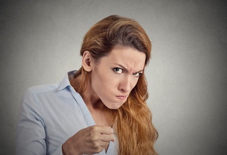 bitchy: portrait angry woman on grey background. Negative emotion