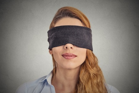 Blindfolded red haired woman photo