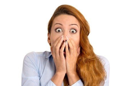 blown away: Surprise astonished woman. Closeup portrait woman looking surprised in full disbelief wide open mouth isolated on white background. Positive human emotion facial expression body language. Funny girl Stock Photo