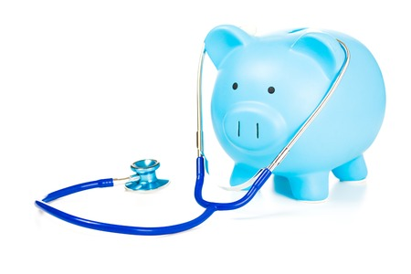 health care funding: Piggy bank and stethoscope Isolated on white background. Health care cost. Financial state condition self assessment concept. Financial system checkup or saving for medical insurance costs