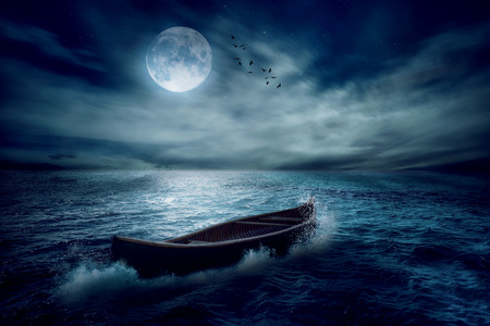 Boat drifting away from past in middle of ocean after storm without course on moonlight sky night skyline clouds background. Conceptual nature landscape screen saver. Life saver  future hope concept