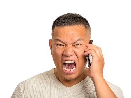 anger management: Closeup portrait headshot angry middle aged man, guy mad worker, pissed off employee shouting while on phone isolated on white background. Negative human emotion face expression feeling attitude