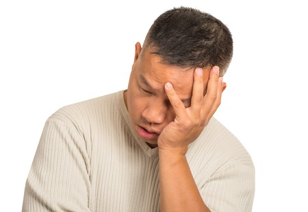 headshot: Closeup portrait headshot sad bothered stressed middle aged man holding head with hand really depressed about something isolated on white background. Negative human emotion facial expression feeling