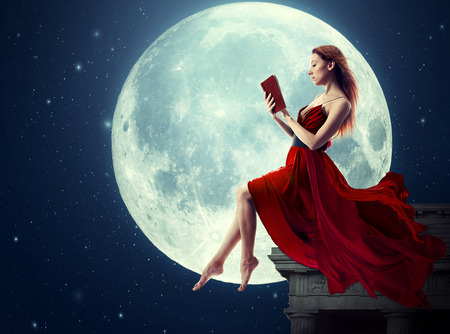 Cute woman, female reading book, moonlight sky night skyline, night skyline clouds background. Dreamy,  nature landscape screen saver, artistic illustration. Archivio Fotografico