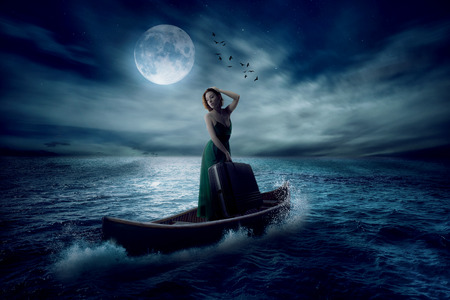 moonlight: Elegant woman with suitcase standing on boat in middle ocean after storm drifting away with moonlight sky clouds background. Conceptual landscape screen saver.