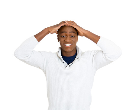 american media: Closeup portrait happy young handsome man looking shocked surprised in full disbelief hands on cheek head open mouth eyes isolated white background. Positive human emotion facial expression feeling