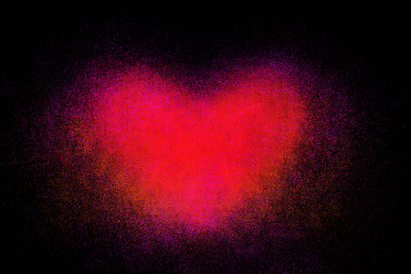 dust cloud: Freeze motion of heart shaped red powder isolated on black, dark background. Abstract design of dust cloud. Particles explosion screen saver, wallpaper with copy space. Love, passion, feelings concept