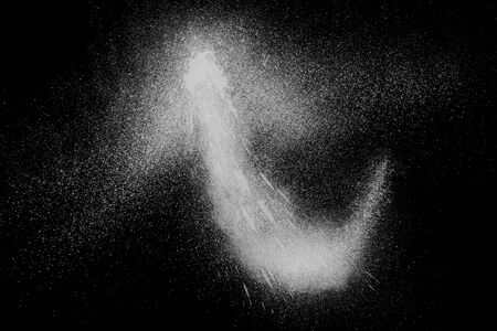 dust cloud: Freeze motion of white powder exploding, isolated on black, dark background. Abstract design of white dust cloud. Particles explosion screen saver, wallpaper with copy space. Planet creation concept