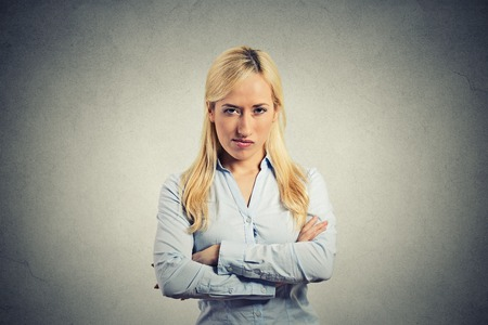 portrait angry blonde woman on grey background Stock Photo