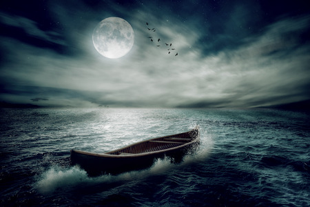 business trip: Boat drifting away in middle ocean after storm without course moonlight sky night skyline clouds background. Nature landscape screen saver. Life hope concept. Elements of this image furnished by NASA