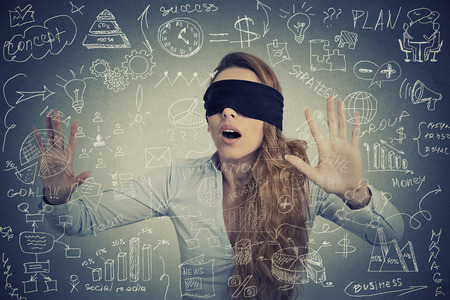 Blind young businesswoman making plans navigating through social media