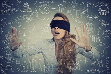 navigating: Blind young businesswoman making plans navigating through social media