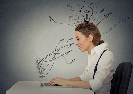 Side view profile attractive happy business woman working on laptop computer isolated grey wall background. Internet creativity network concept
