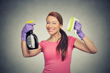 young add: Happy woman holding brush and detergent cleaning solution bottle