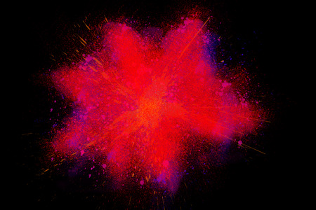 Freeze motion of colorful powder paint exploding isolated on black dark background. Abstract design of color dust cloud. Particles explosion screen saver, wallpaper, brush
