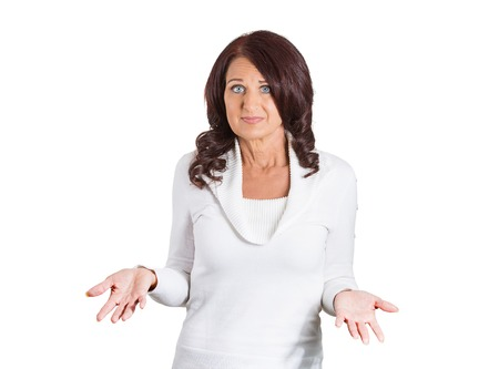 ambiguous: Portrait dumb looking woman arms out shrugs shoulders who cares so what I dont know isolated on white background. Negative human emotion, facial expression body language life perception attitude