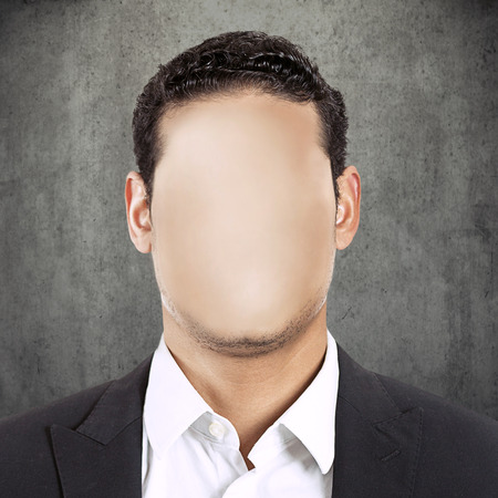 headshot faceless man isolated on grey wall texture background. Lack of human individuality concept. No face