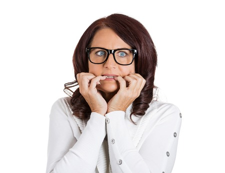 middle adult: Closeup headshot portrait unhappy scared anxious woman with glasses. Female biting nails looking with craving, envy for something worried isolated on white background. Human face expression emotions