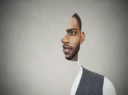 arte optico: frente retrato surrealista con el perfil recortado de un joven aislado en el fondo de la pared gris